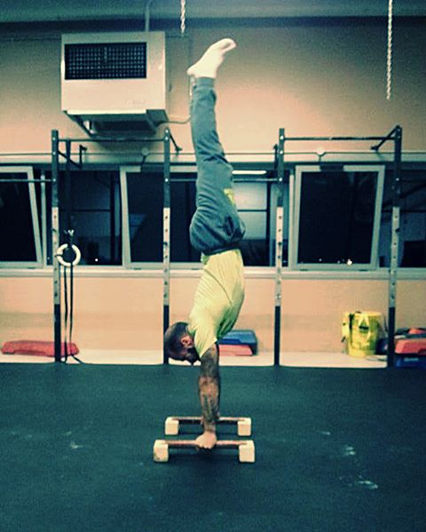 A man performing handstand push ups