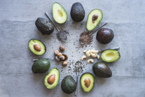 A selection of avocados, nuts and seeds