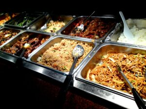 A Buffet Containing Rice, Noodles, Meat, etc.
