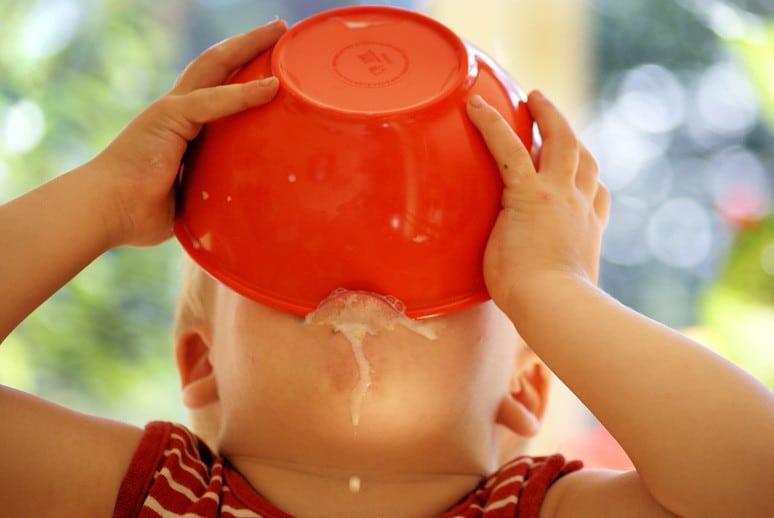 A Child Eating Directly From a Bowl