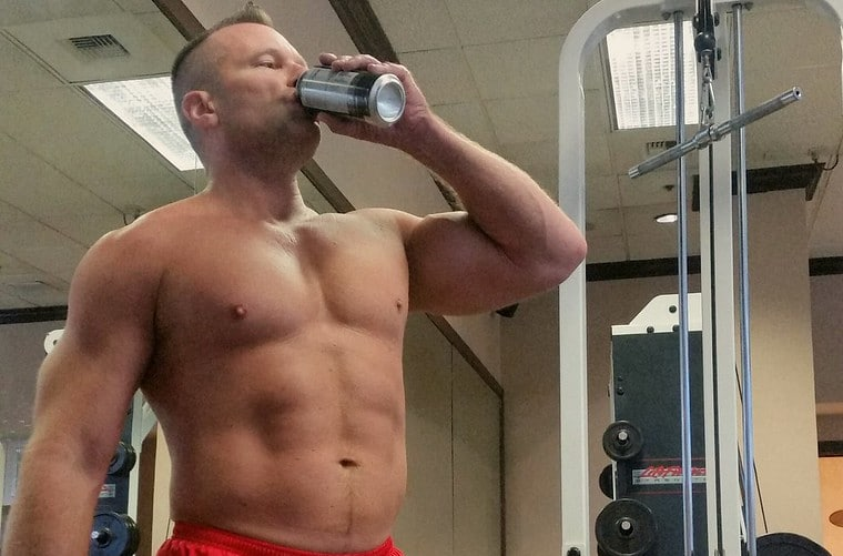 A Man Drinking a Protein Shake - Why Does Muscle Burn More Calories Than Fat? - Protein Synthesis