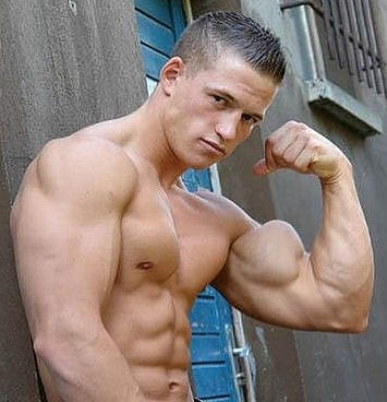 A Man Tensing His Biceps