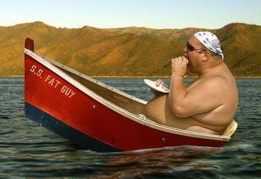 A Large Man Eating While Sat in a Boat Named 'S.S. Fat Guy'