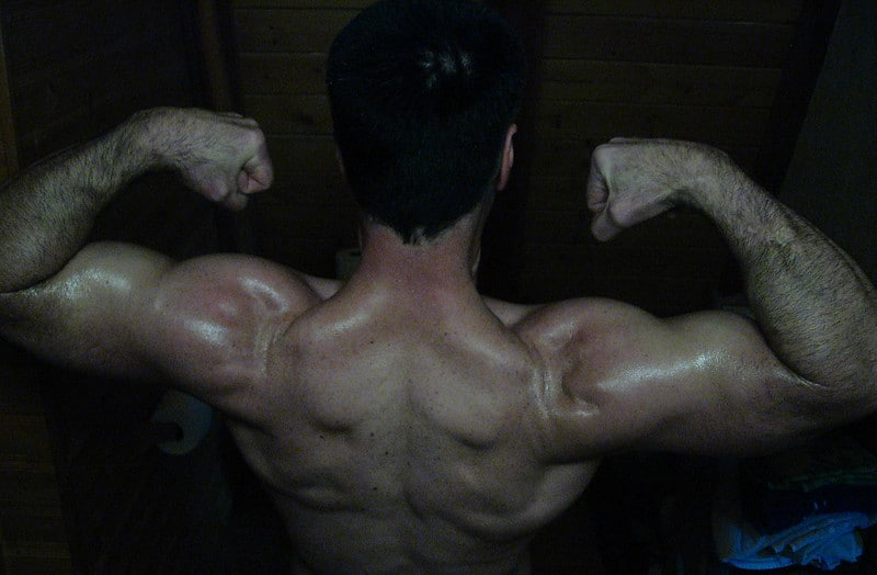 A Man Flexing His Back Muscles