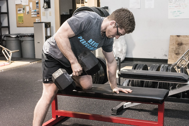 A Man Performing a One-Arm Dumbbell Row