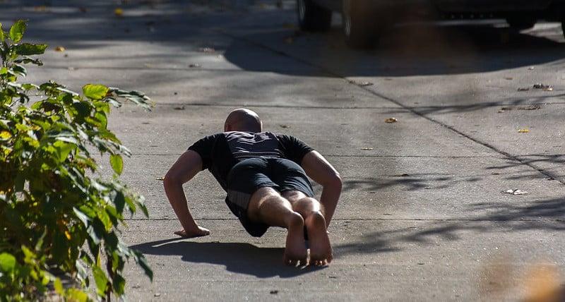 A Man Performing Push Ups Outdoors
