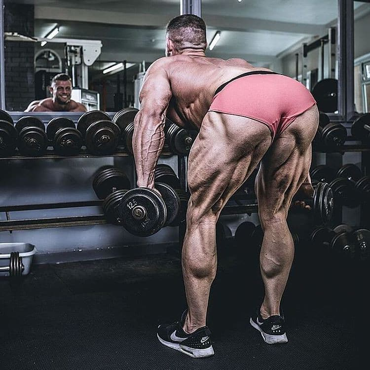 A Man Performing Romanian Deadlifts with Dumbbells