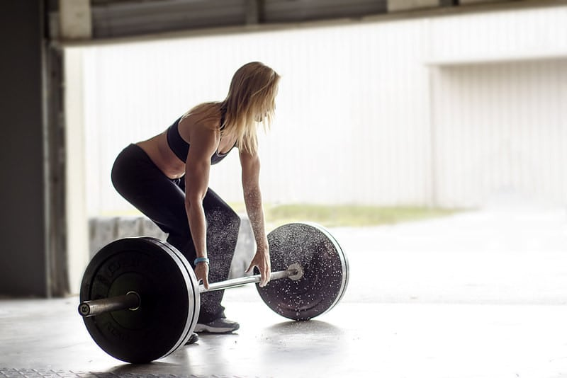 A Woman Performing Deadlifts