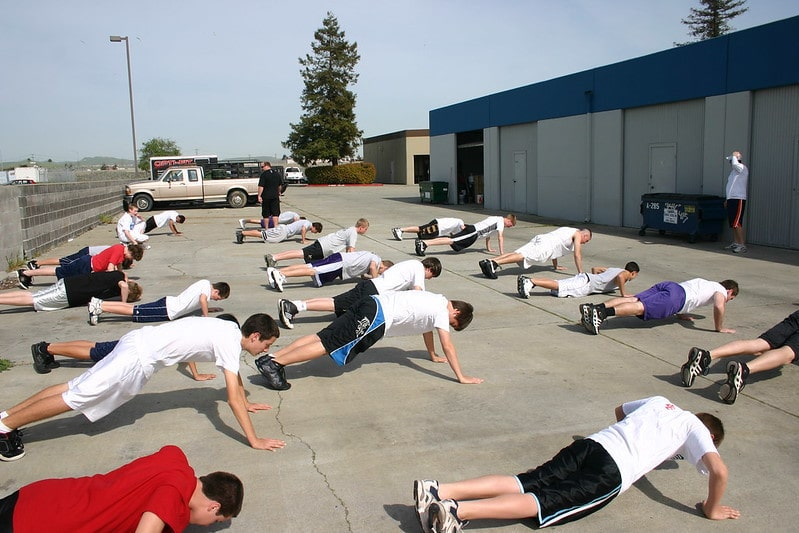 A Group of People Doing Push Ups