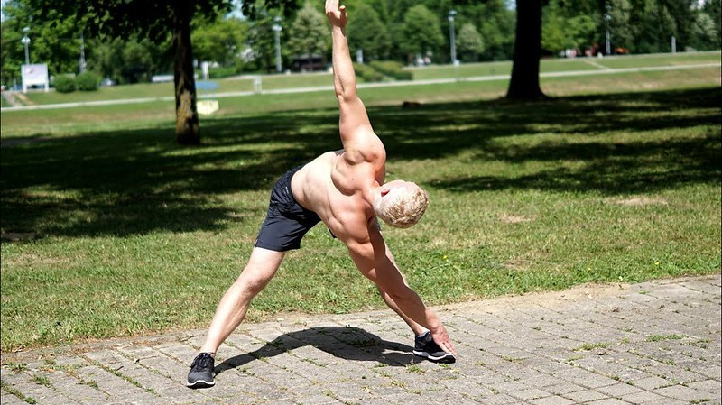 A Man Doing Bodyweight Exercises in the Park