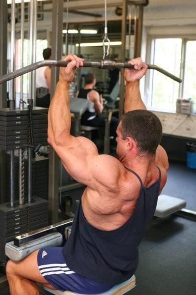 A Man Doing Underhand Grip Lat Pulldowns