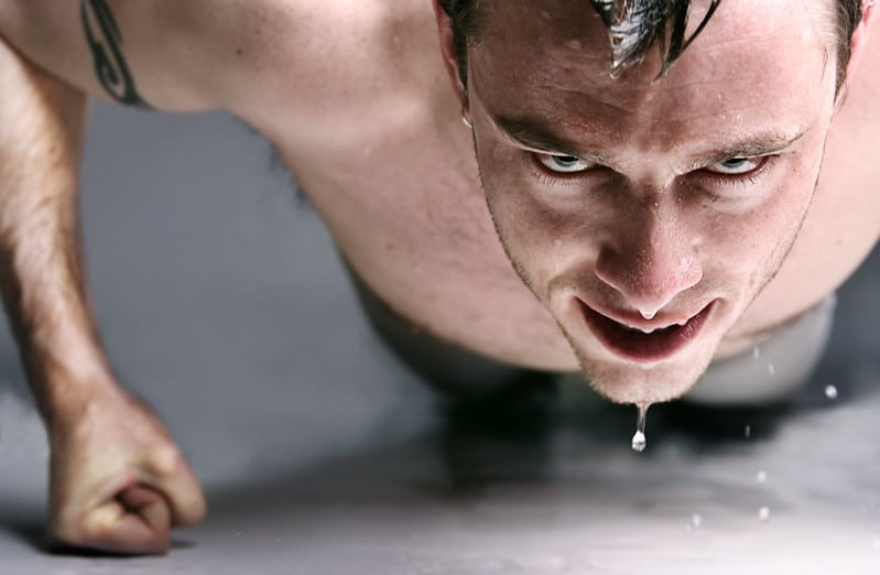 A Man Performing One-Arm Push Ups