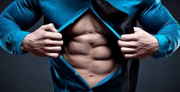 A Man Ripping Open His Shirt to Reveal 6-Pack Abs