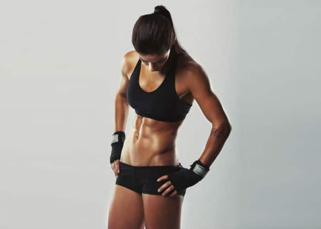 An Athletic Woman Staring Down at Her Hip Flexors