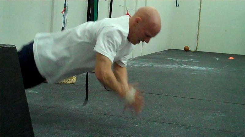 A Man Doing Clapping Hand Push Ups
