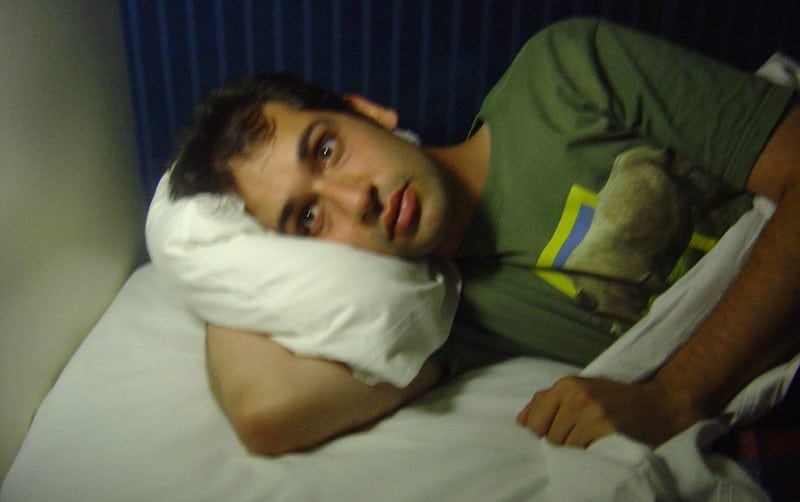 A Man Lying in Bed Unable to Sleep