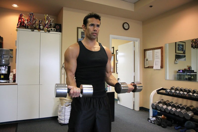 A Man Performing Dumbbell Bicep Curls