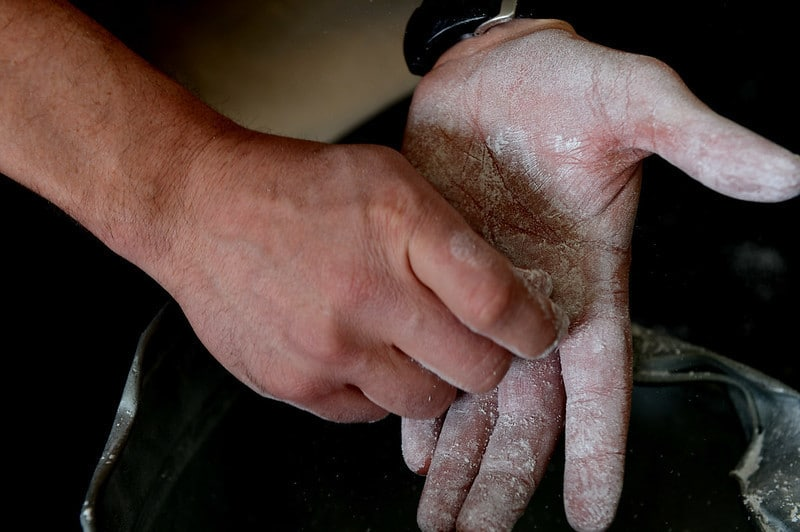 A Person Applying Weightlifting Chalk to Their Hands