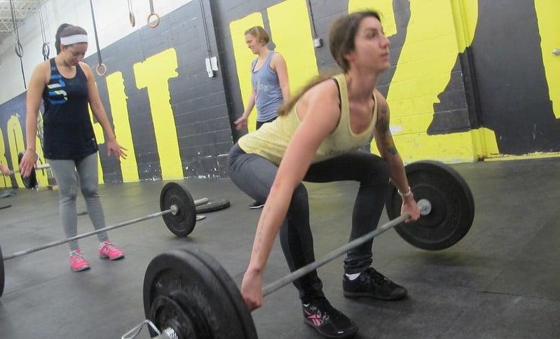 A Woman Performing Snatch-Grip Deadlifts