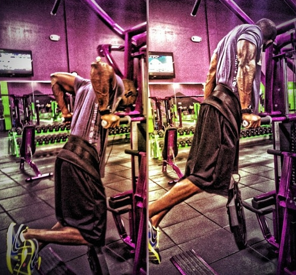 A Man Doing Weighted Tricep Dips