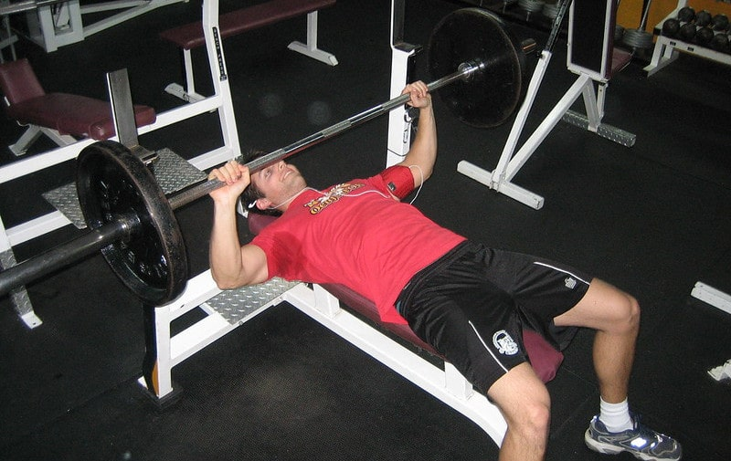 A Man Performing a Bench Press