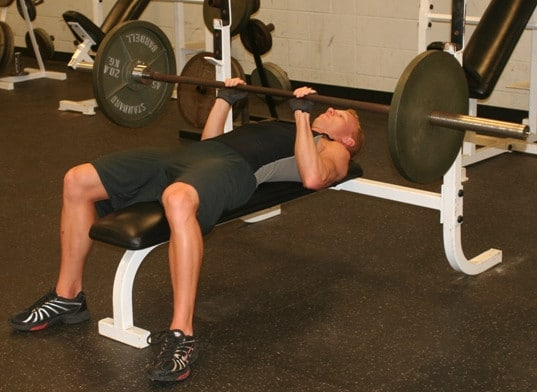 A Man Performing the Close Grip Bench Press