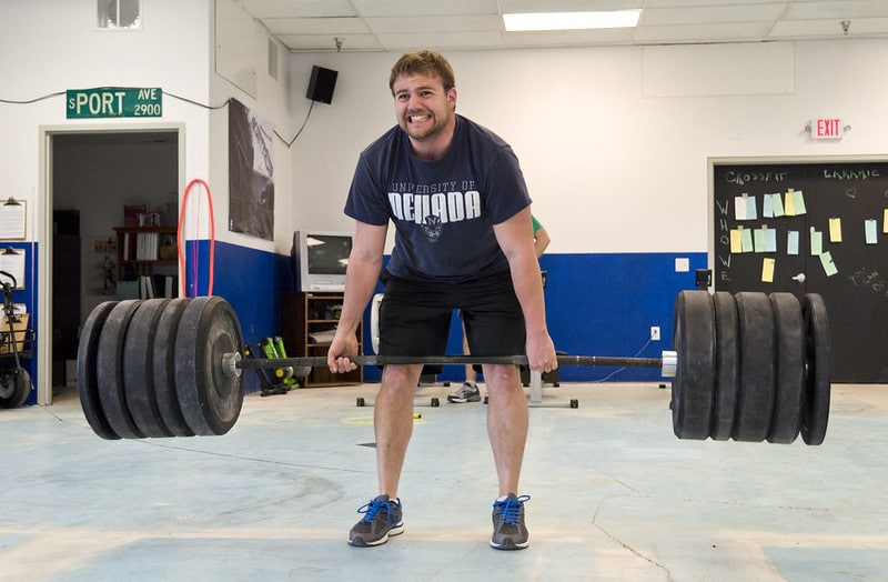 A Man Straining Himself to Lift a Heavy Deadlift