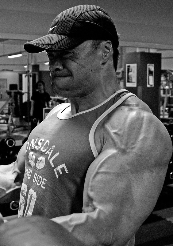 A Muscular Man Performing Bicep Curls