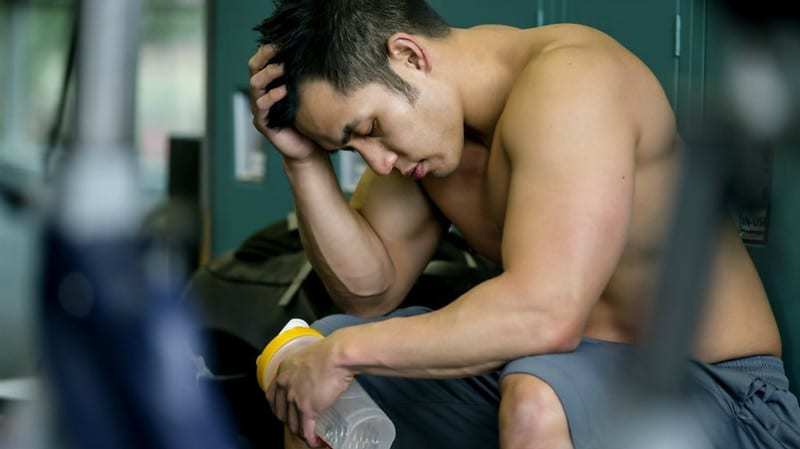 An Athletic Man Looking Tired After a Workout