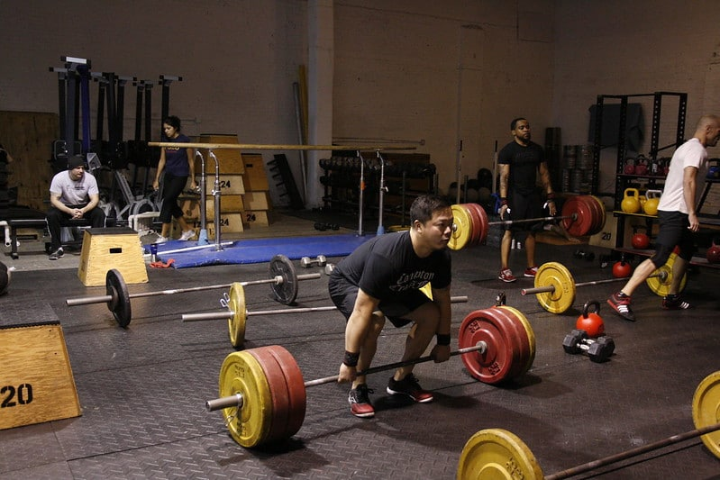 People in a Crossfit Gym Performing Deadlifts