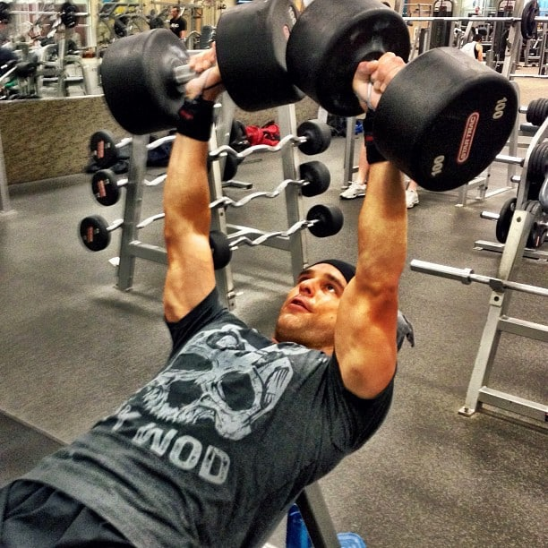 A Man Performing Incline Dumbbell Chest Press