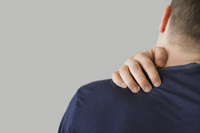 A Man With Neck/Upper Back Pain