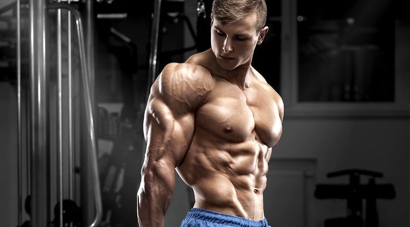 A Muscular Man Tensing His Triceps