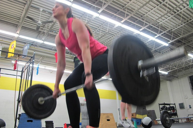 A Woman Performing Deadlifts With Het Torso Becoming Vertical Too Early