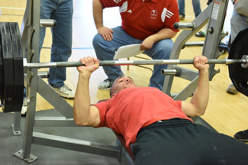 A Man Performing The Bench Press
