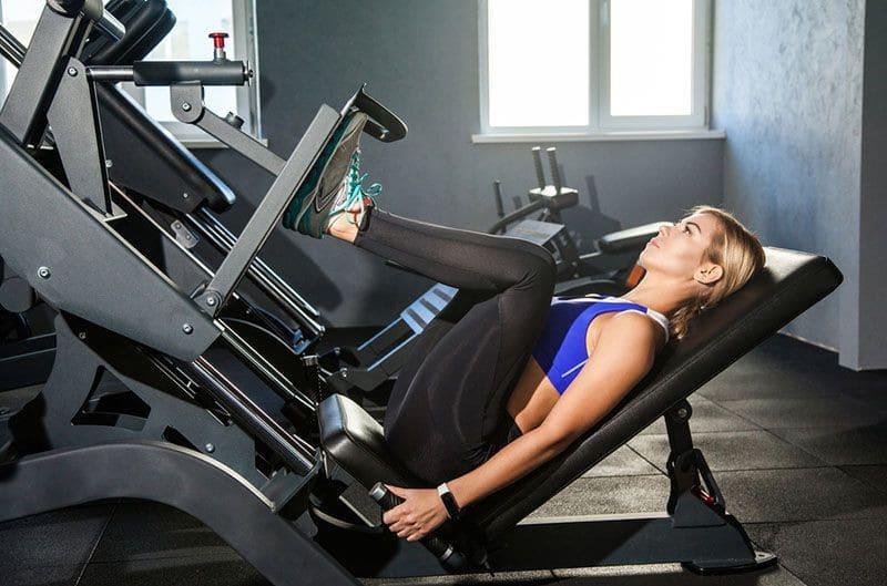 A Woman on the Leg Press Machine