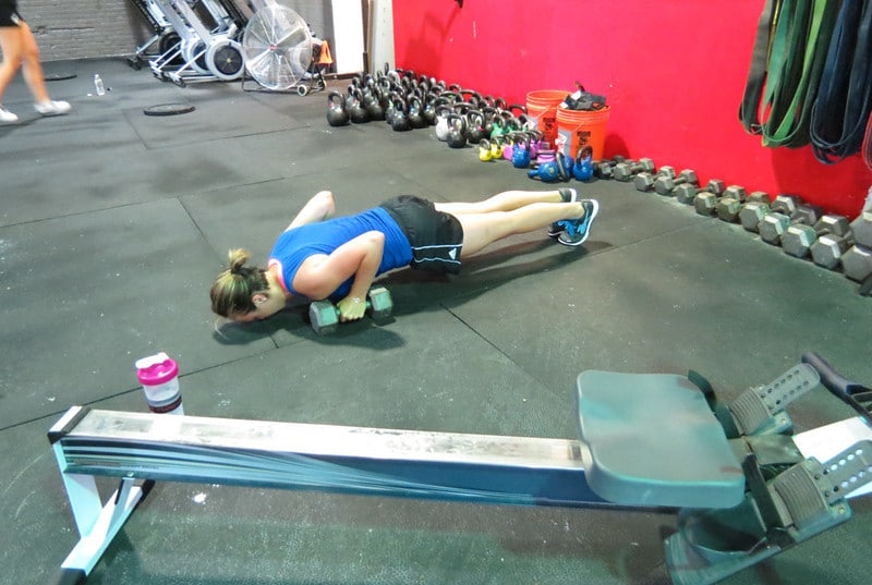 A Woman Perform Push Ups in the Gym