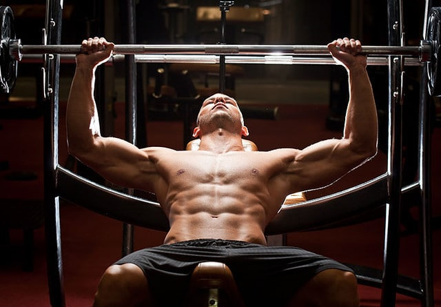 A Man Performing An Incline Bench Press