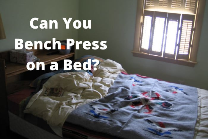 Can You Bench Press on a Bed