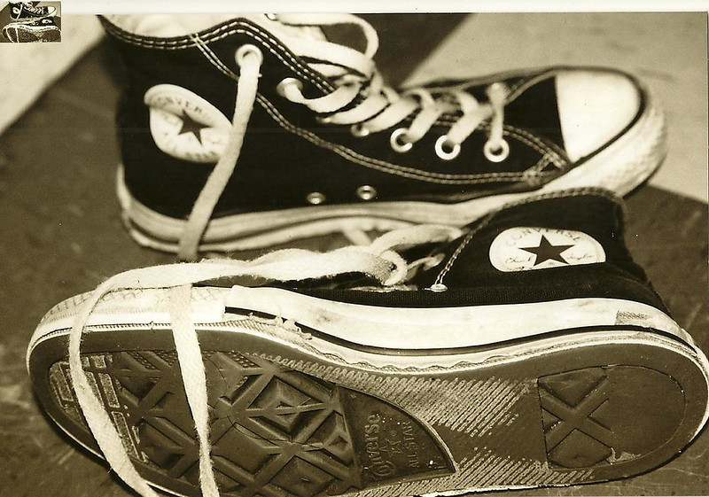 A Pair of Black and White Converse Shoes