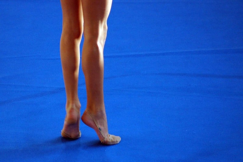 A Pair of Legs Standing on Tip Toes
