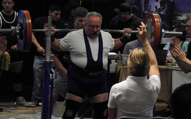 A Powerlifter Getting Ready to Squat at a Competition