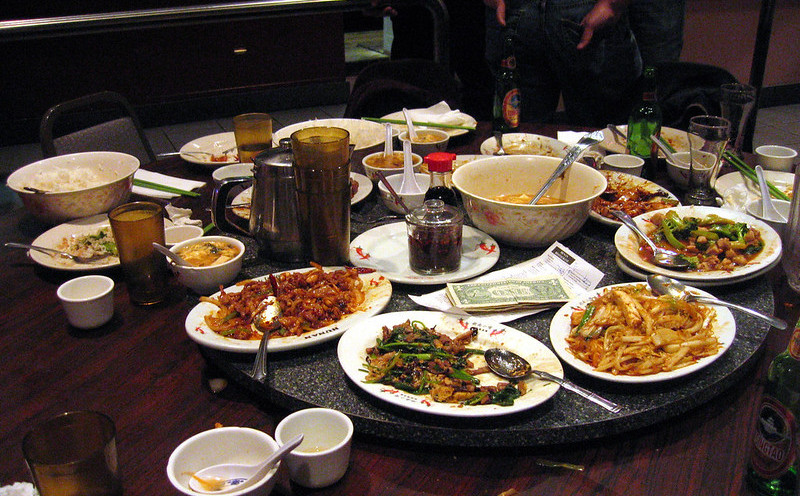 A Table With Lots of Plates of Food