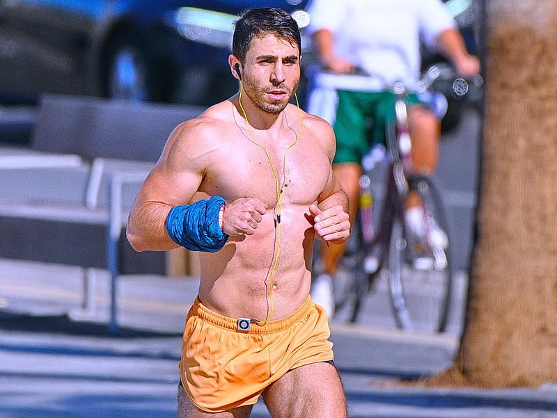 An Athletic Man Running Outside