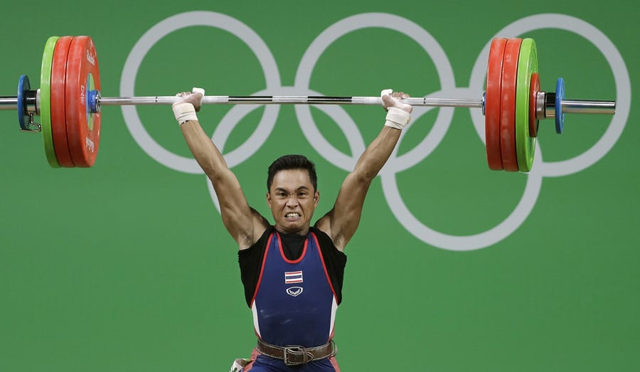 An Olympic Weightlifter Holding a Heavy Barbell Overhead