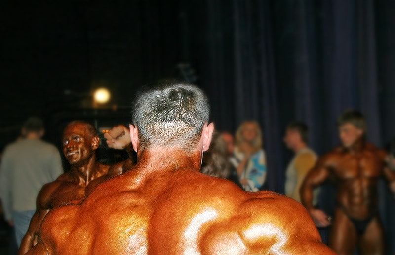 Bodybuilders and Other People Backstage at a Bodybuilding Contest