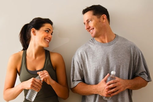A Girl and a Guy Flirting at the Gym
