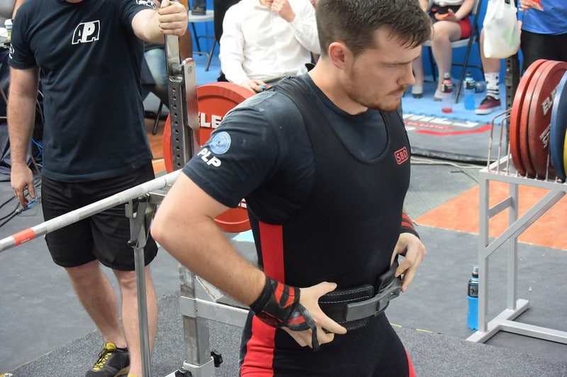 A Crossfit Athlete Adjusting His Weight Belt